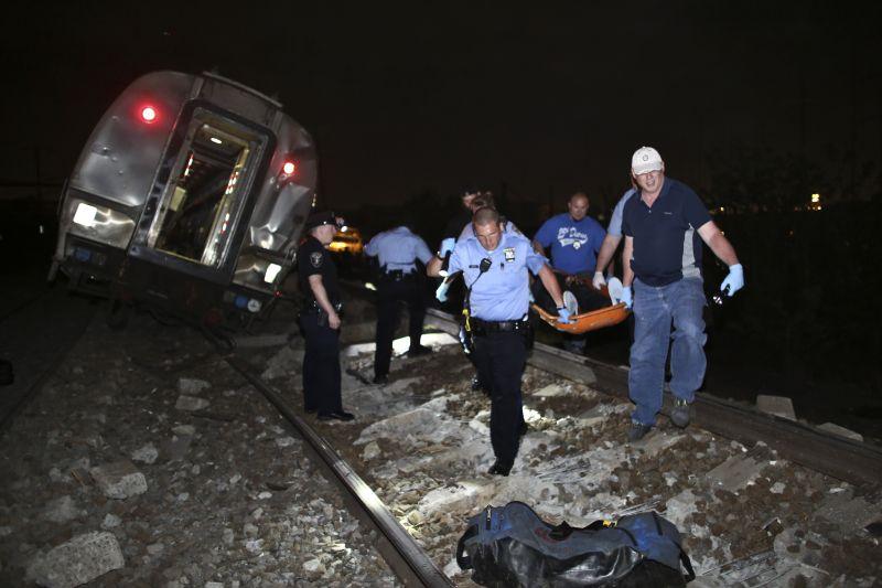 Emergency personnel rescue Amtrak derailment victims