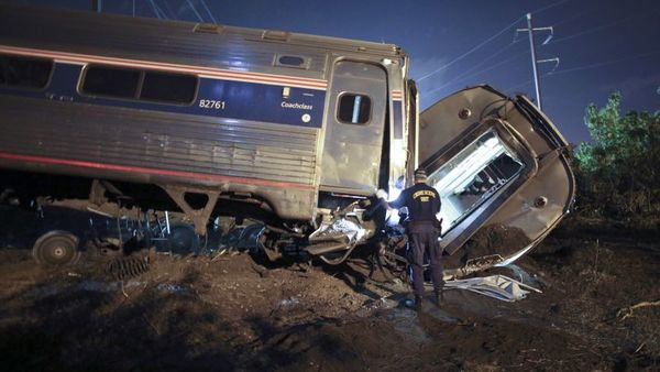 In this May 12, 2015, file photo, emergency personnel work the scene of a deadly train wreck in Philadelphia. An Amtrak train headed to New York City derailed and crashed in Philadelphia. Federal authorities continue to investigate the crash that killed eight people and injured more than 200. The train derailed while traveling more than twice the speed limit around a curve; travel along the Northeast Corridor was disrupted for days while the tracks were replaced. (AP Photo/ Joseph Kaczmarek, File)