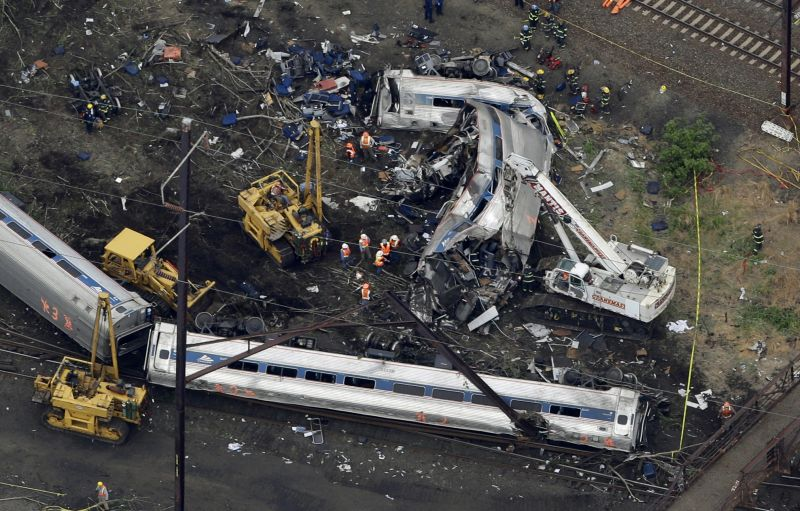 emergency personnel work at the scene of a deadly train derailment in Philadelphia