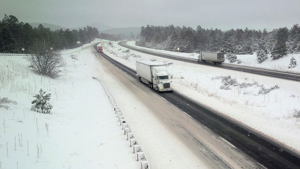 Trucks maneuver along a single, cleared lane in each direction of Interstate 40 west of Flagstaff, Ariz., Monday, Feb. 1, 2016. A winter storm dropped rain and snow on Arizona, creating hazardous driving conditions in some areas while resulting in scattered school closures and delayed openings. (Photo: Arizona DOT via AP Photo)
