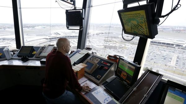 An air traffic controller labors in the tower at Newark Liberty International Airport, Thursday, May 21, 2015, in Newark, N.J. (AP Photo/Julio Cortez)