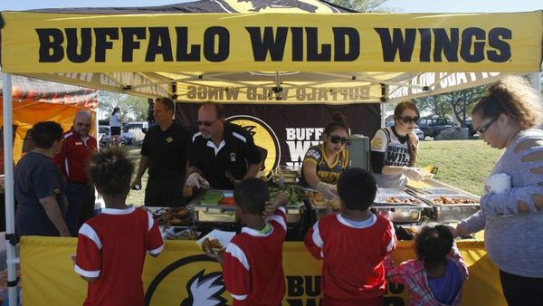 A Buffalo Wild Wings flag football tournament during the BGCA All-stars event on Saturday, Nov. 7, 2015 in Gilbert, Ariz. (Rick Scuteri/AP Images for Boys & Girls Clubs of America)