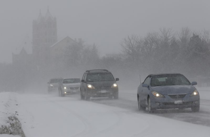 Traffic slowly moves down Waukegan Road on Sunday, Feb. 15, 2015, in Northbrook, Ill.