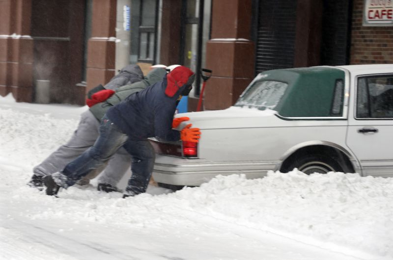 Good samaritans try to push a car stuck in the snow in Trenton, N.J.