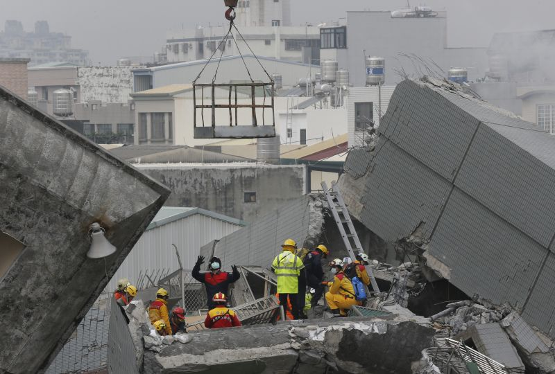 Rescue teams continue to search for the missing in a collapsed building