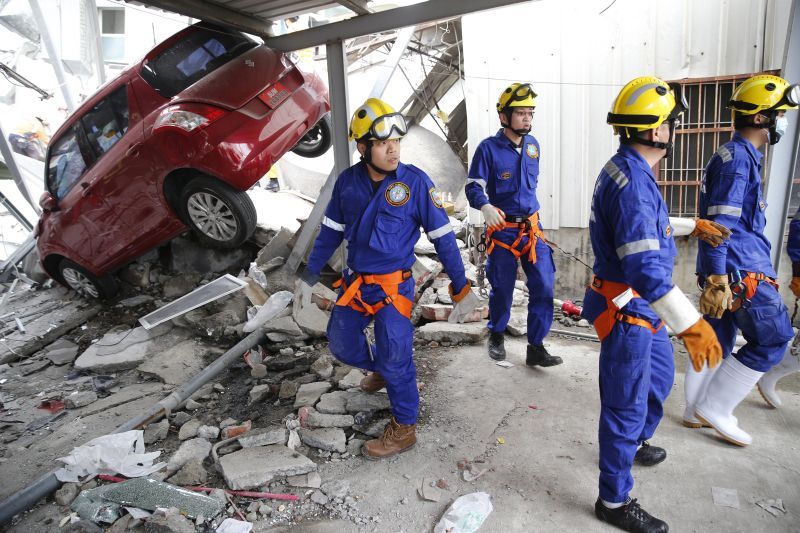 Rescue workers search a collapsed building