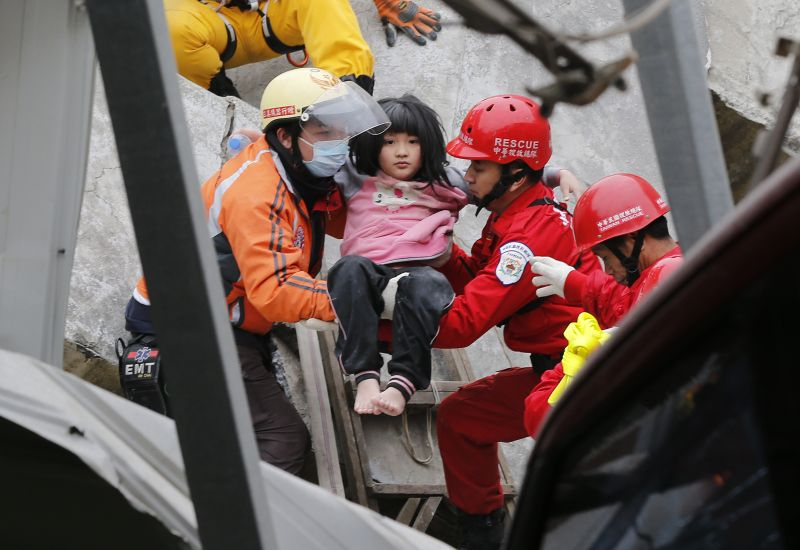 A young girl is rescued from a collapsed building