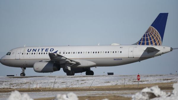In this photograph taken late Monday, Feb. 8, 2016, a United Airlines craft waits to take off from a runway at Denver International Airport. (AP Photo/David Zalubowski)