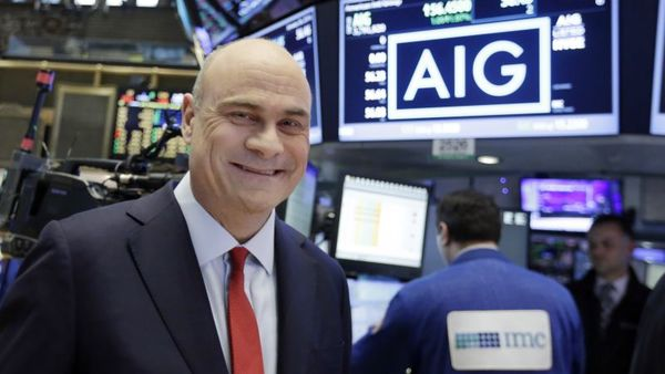 AIG President and CEO Peter Hancock visits the floor of the New York Stock Exchange, Tuesday, Jan. 26, 2016. (AP Photo/Richard Drew)