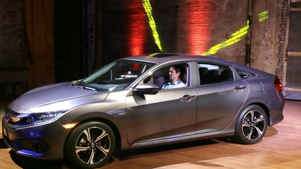 One of America's most popular cars for decades, the Civic sedan for 2016 has stylish new looks, a roomier interior, more features than ever and two new engines, including Honda's first turbocharged engine for the United States. Fuel economy is improved, too. (AP Photo/Carlos Osorio, File)