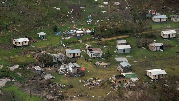 In this Sunday, Feb. 21, 2016 aerial photo supplied by the New Zealand Defense Force, debris is scattered around damaged buildings at Nakama settlement in Fiji, after Cyclone Winston tore through the island nation. Fijians were finally able to venture outside Monday after authorities lifted a curfew but much of the country remained without electricity in the wake of a ferocious cyclone that left at least six people dead and destroyed hundreds of homes. (New Zealand Defense Force via AP)