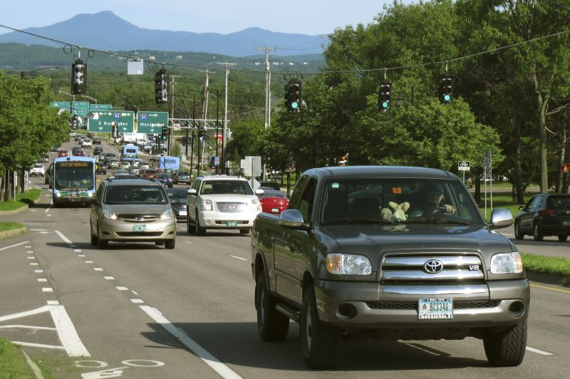 In this Wednesday June, 17, 2015 photo, vehicles travel along Williston Road during the afternoon rush hour in Burlington, Vt.