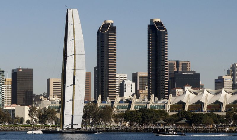 In this Nov. 25, 2009 file photo, The BMW Oracle trimaran sails past the San Diego skyline during testing in San Diego