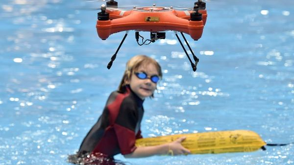 A water drone demonstrates maritime salvage by flying a lifesaver to a boy in the water, at the world's largest watersports trade fair BOOT in Duesseldorf, Germany, Friday, Jan. 22, 2016. (AP Photo/Martin Meissner)