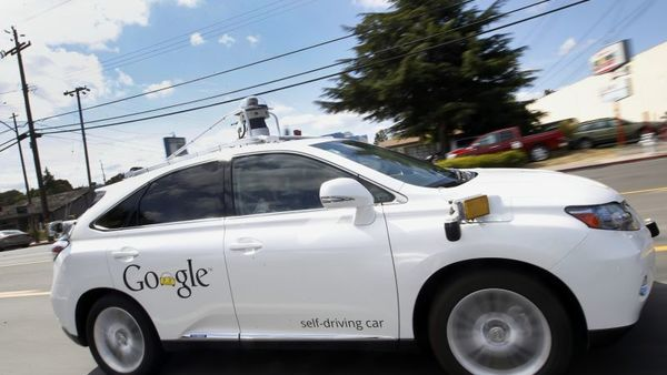 In this May 13, 2015, file photo, Google's self-driving Lexus car drives along street during a demonstration at Google campus in Mountain View, Calif. A self-driving car being tested by Google struck a public bus on a city street, a fender-bender that appears to be the first time one of the tech company's vehicles caused an accident. The collision occurred on Valentine's Day and Google reported it to California's Department of Motor Vehicles in an accident report that the agency posted Monday, Feb. 29. (AP Photo/Tony Avelar, File)