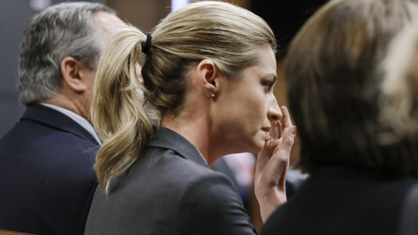 Sportscaster and television host Erin Andrews wipes tears as the verdict is read Monday, March 7, in Nashville, Tenn. A jury has awarded Andrews $55 million in her lawsuit against a stalker who bought a hotel room next to her and secretly recorded a nude video, finding that the hotel companies and the stalker shared in the blame. (Photo: Mark Humphrey/AP Photo)