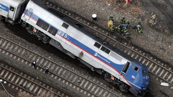 In this In this Dec. 1, 2013 file photo, a Metro-North locomotive lies on its side after derailing in the Bronx borough of New York. The National Transportation Safety Board said Tuesday, Oct. 28, 2014 that the sleep-deprived engineer nodded off at the controls of the commuter train just before taking a 30 mph curve at 82 mph, causing the derailment that killed four people and injured more than 70. (AP Photo/Mark Lennihan, File)