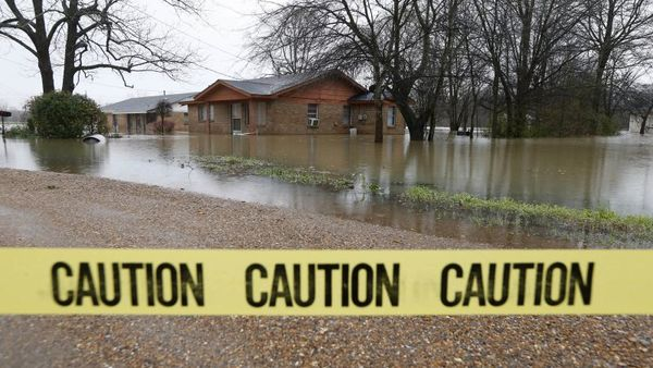 Caution tape closes off this neighborhood in Drew, Miss., Friday, March 11, as floodwaters have affected areas in the Delta. (Photo: Rogelio V. Solis/AP Photo)