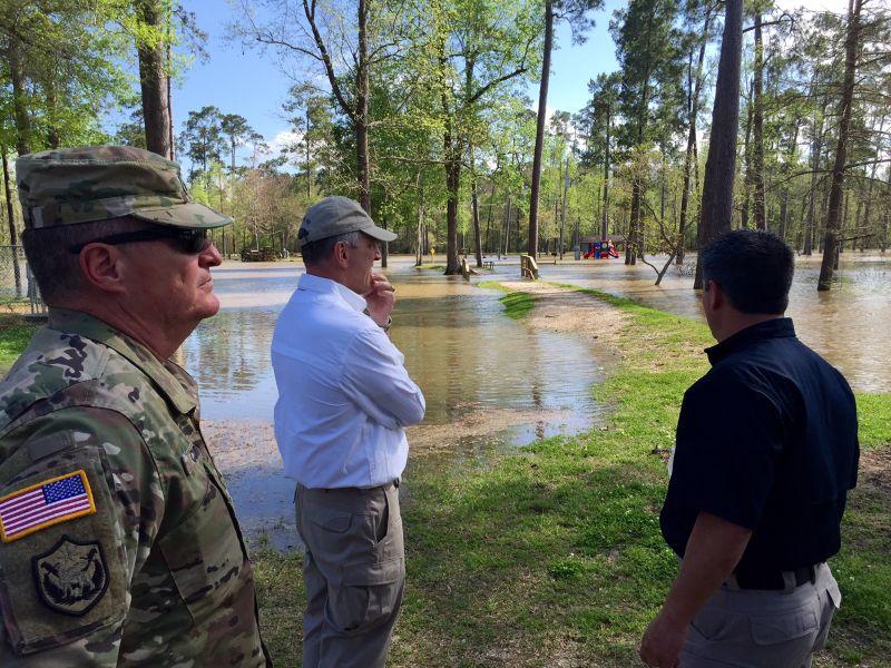 Louisiana Gov. John Bel Edwards surveys floods in Vinton, La., Sunday, March 13, 2016