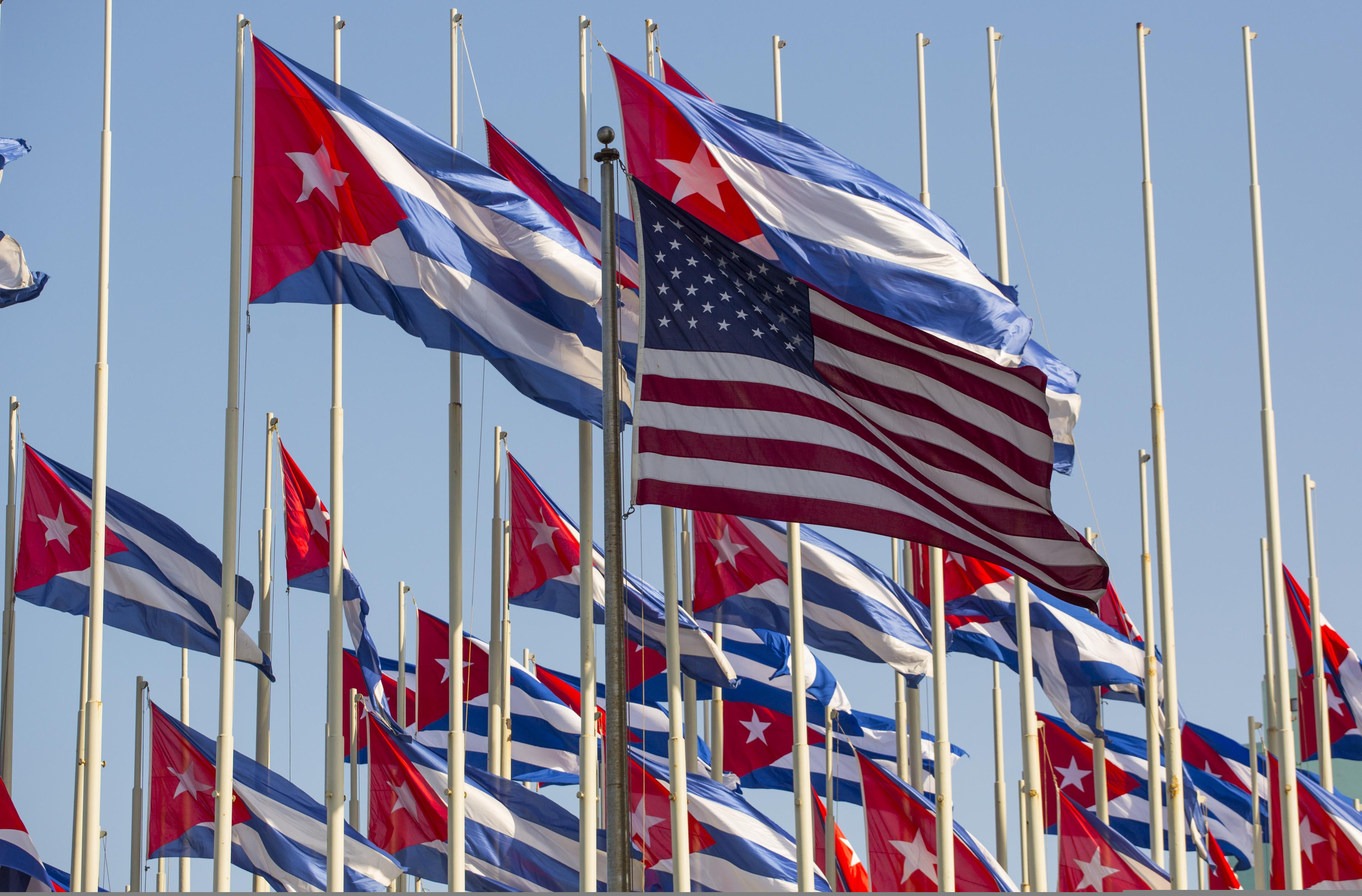 The U.S. flag flies outside the U.S. embassy near many Cuban flags hoisted on Revolution Day, in Havana, Cuba, Friday, Jan. 1, 2016. (AP Photo/Desmond Boylan)