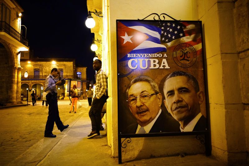 "A poster features portraits of Cuba's President Raul Castro, left, and U.S. President Barack Obama and reads in Spanish ""Welcome to Cuba"" outside a restaurant in Havana, Cuba, Thursday, March 17, 2016."