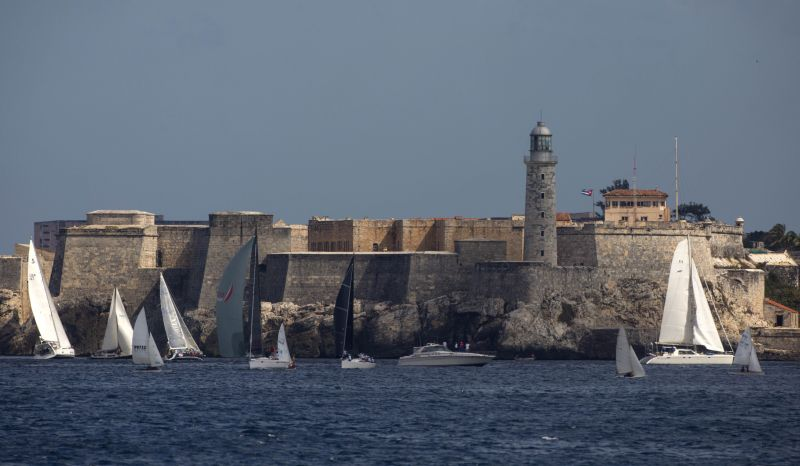 Yachts from the U.S. take part in the Conch Republic Cup Key West Cuba race week in front of the lighthouse of the Morro Cabana Fortress in Havana, Cuba, Wednesday, Feb. 3, 2016