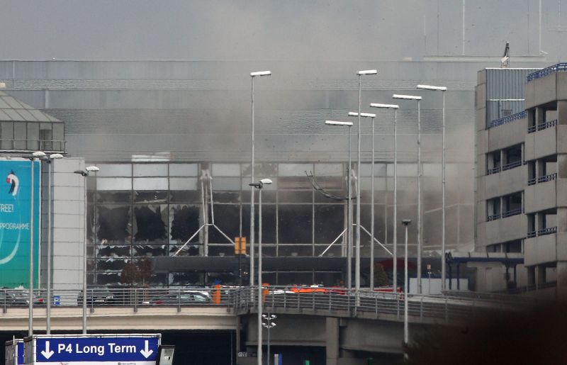 Smoke billows from the Zaventem Airport after a controlled explosion in Brussels