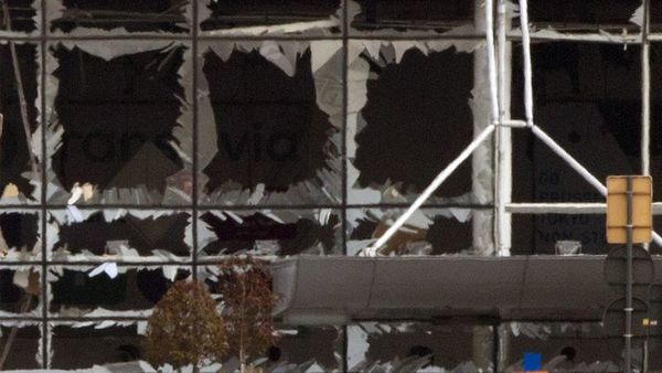 The blown out windows of Zaventem airport are seen after a deadly attack in Brussels, Belgium, Tuesday, March 22, 2016. Authorities in Europe have tightened security at airports, on subways, at the borders and on city streets after deadly attacks Tuesday on the Brussels airport and its subway system. (AP Photo/Peter Dejong)