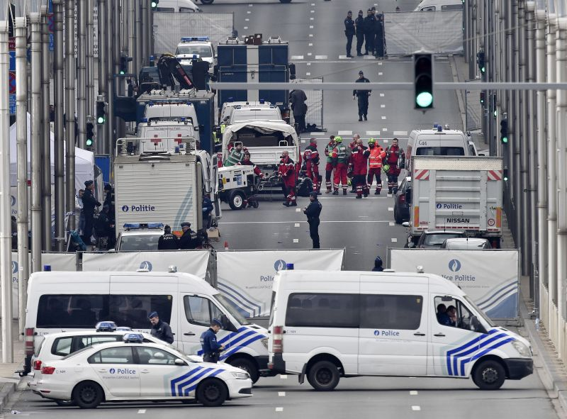 Police and rescue teams are pictured outside the metro station Maelbeek in Brussels
