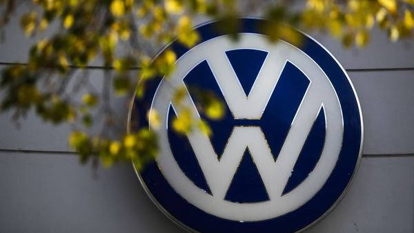 The VW sign of Germany's Volkswagen car company is displayed at the building of a company's retailer in Berlin. (AP Photo/Markus Schreiber, File)