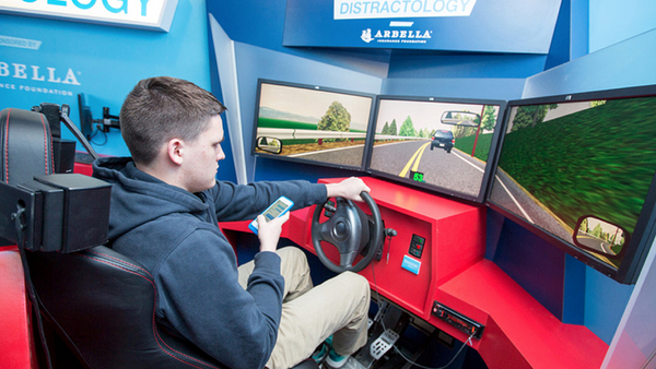 Arbella's Distractology mobile classroom features high-tech driving simulators that high school students spend 45 minutes on dealing with various distract-driving scenarios. (Photo: Arbella Foundation)