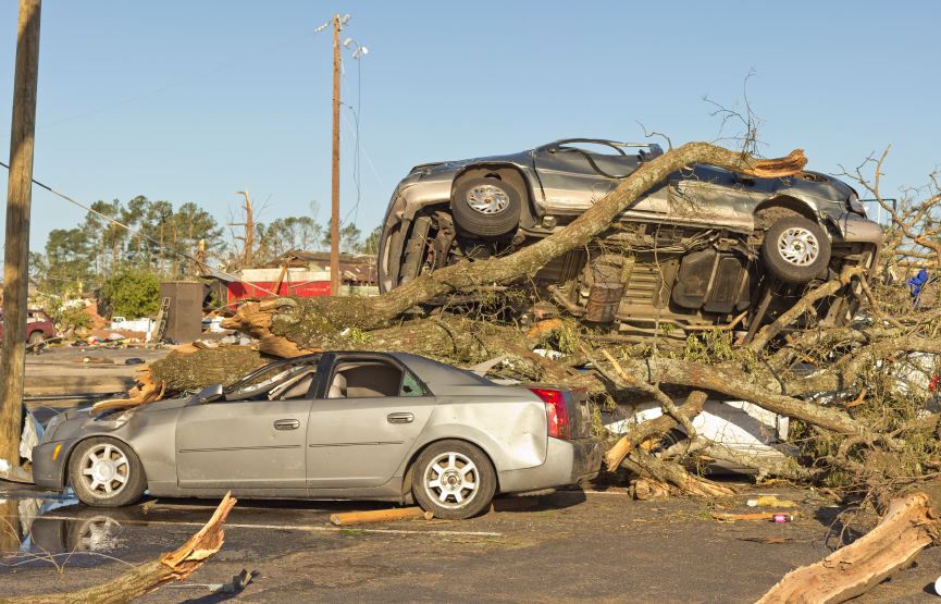Tornado leaves cars stacked on each other