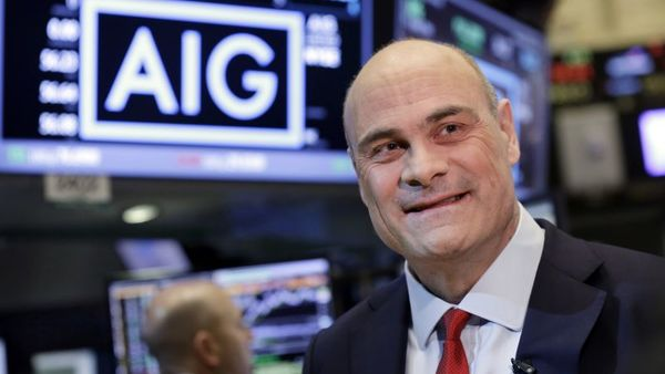 AIG President and CEO Peter Hancock is interviewed on the floor of the New York Stock Exchange, Tuesday, Jan. 26, 2016. (AP Photo/Richard Drew)