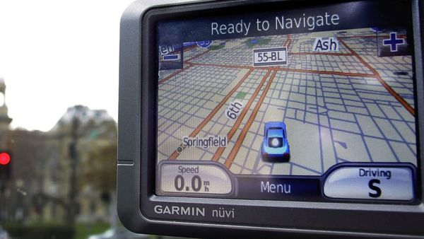 A GPS device is seen in a car outside the Illinois State Capitol in Springfield, Ill. (AP Photo/Seth Perlman)