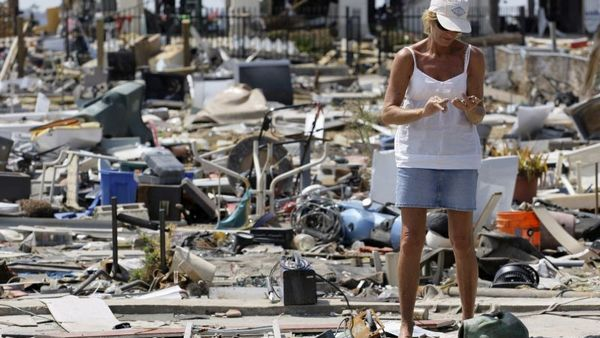 This Sept. 24, 2008, file photo shows Donna Hanson as she pauses to look at an item recovered from debris left where her home once stood in the aftermath of Hurricane Ike in Galveston, Texas. (Photo: David J. Phillip/AP Photo)
