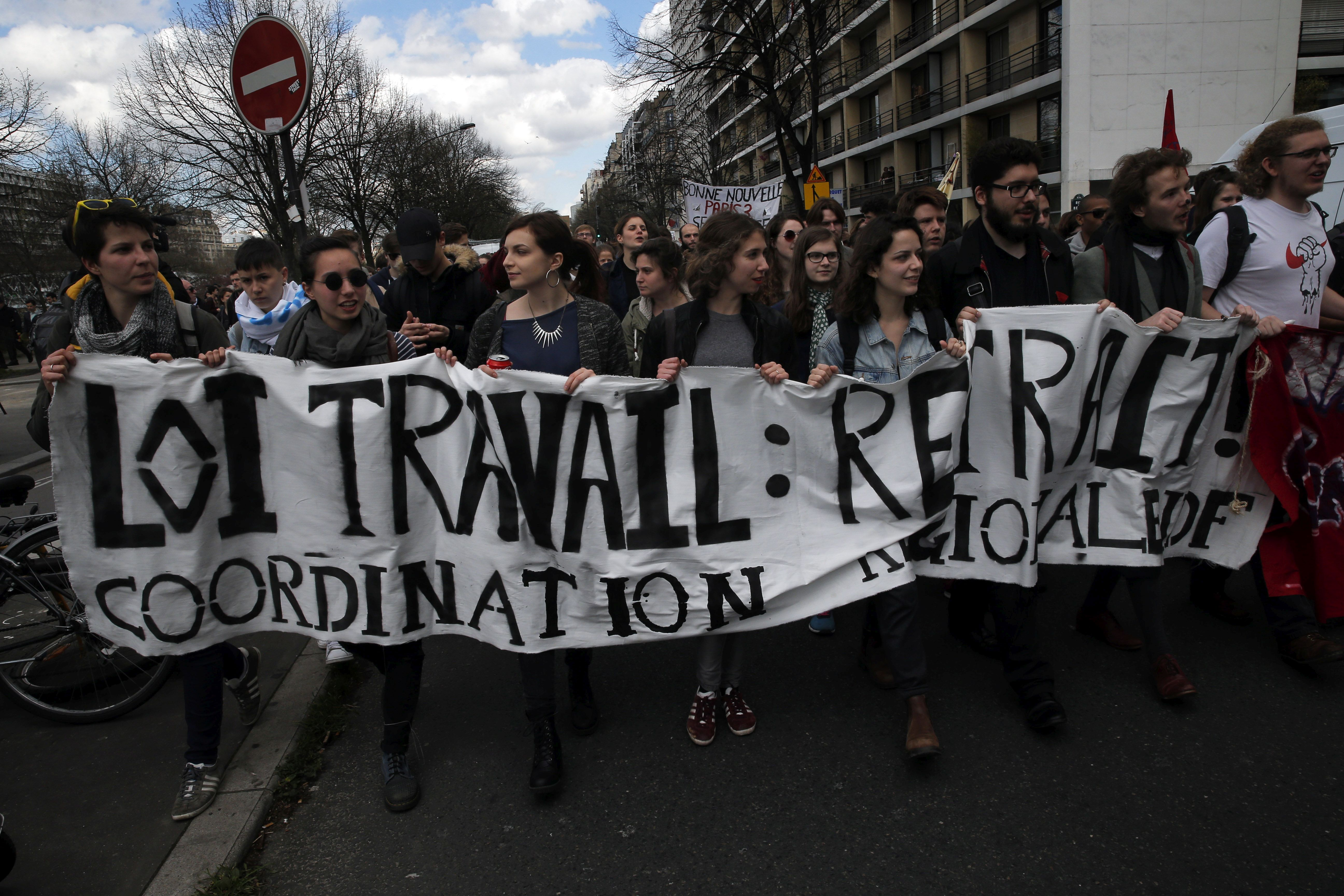 Youth march during a protest against proposed changes to France's work week and layoff practices