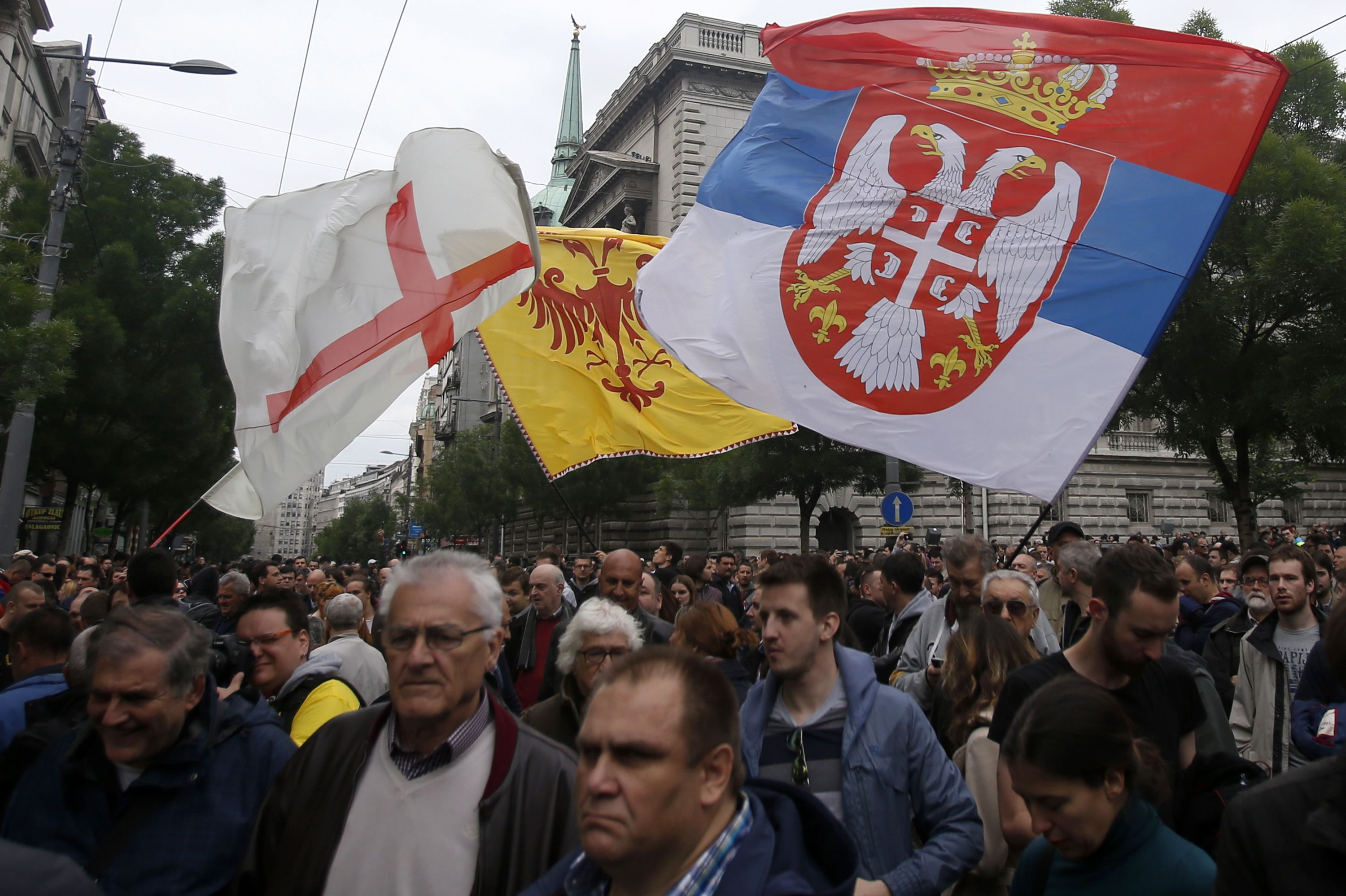 Opposition supporters wave flags during an opposition protest in Belgrade, Serbia