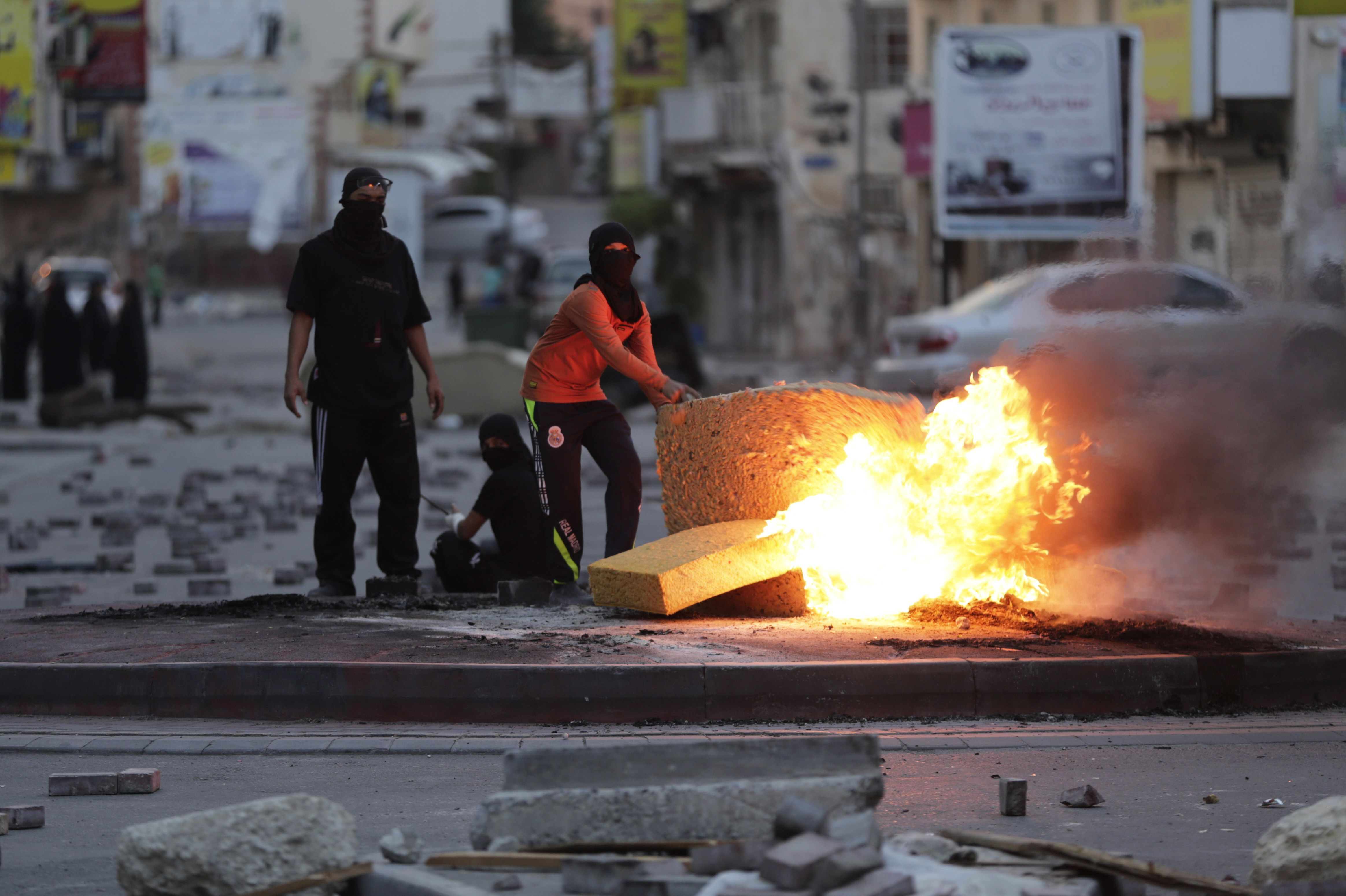 Bahraini anti-government protesters burn old furniture during clashes with riot police