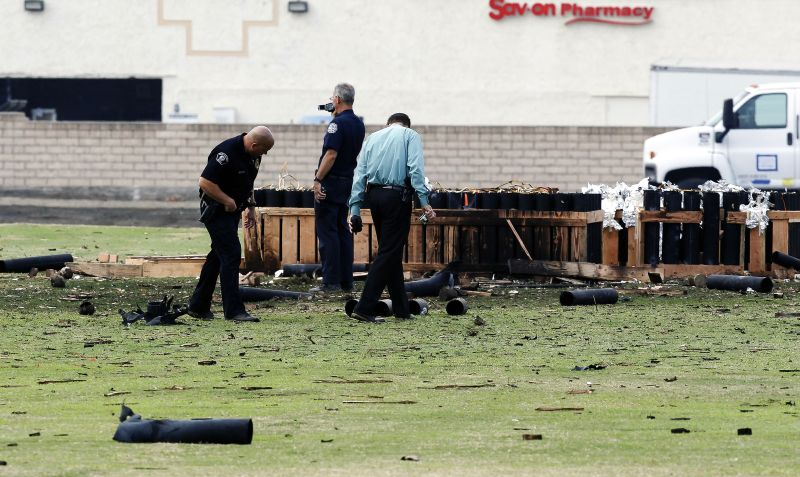Police officials investigate a site in Simi Valley, Calif., Friday July 5, 2013 where an explosion injured more than two dozen people