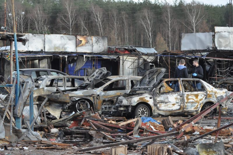 Burnt debris and damaged cars following an explosion at a fireworks stand