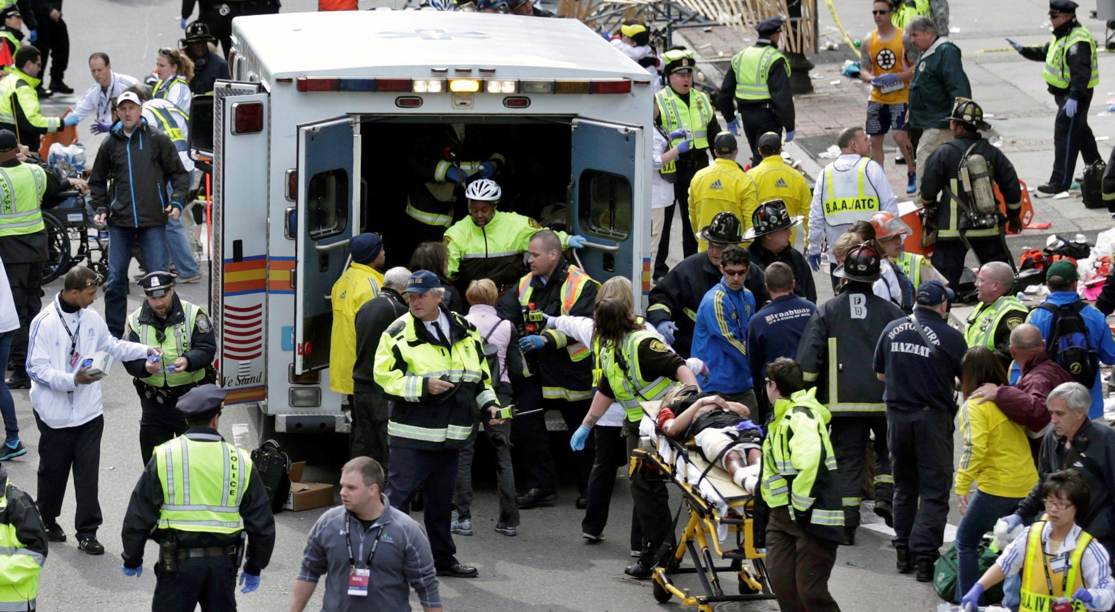 Boston marathon bombing EMTs treating injured