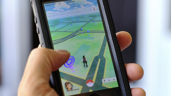 Pokémon Go players have reported wiping out in a variety of ways as they wander the real world, eyes glued to their smartphone screens, in search of digital monsters. (Photo: Richard Vogel/AP Photo)