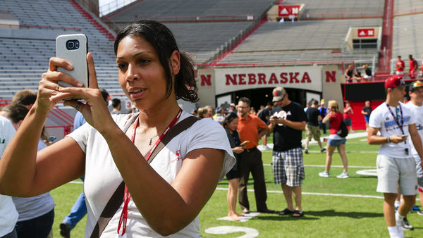 Nicole Warbelton plays during a Pokémon Go event at Memorial Stadium in Lincoln, Neb., last week. Officials opened the stadium for two hours to accommodate Pokémon Go players. (Photo: Nati Harnik/AP Photo)