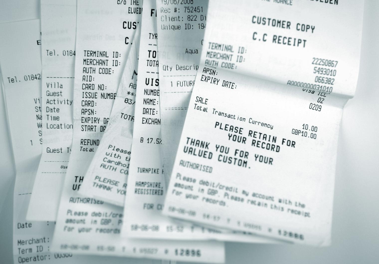 Pile of cash register receipts