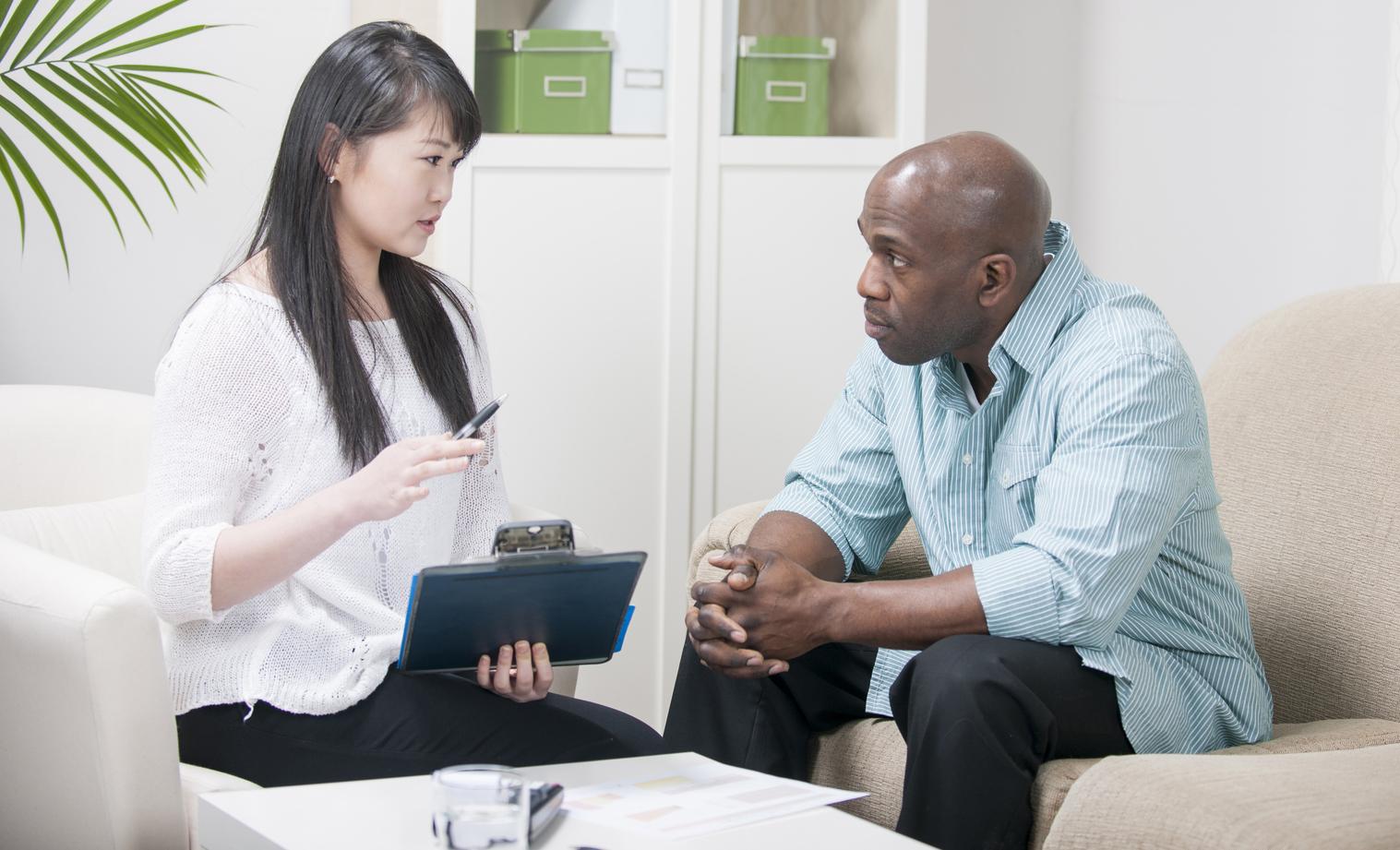 Diverse couple calculating finances