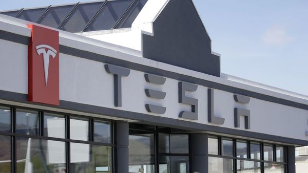 This April 1, 2015, file photo shows the Tesla Motors new showroom in Salt Lake City. (AP Photo/Rick Bowmer, File)