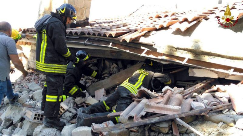 firefighters search for earthquake victims in rubble