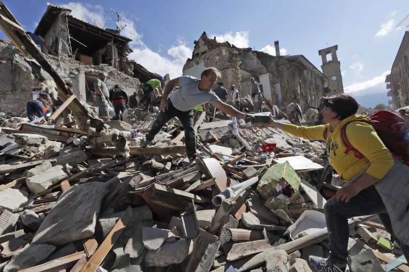 Survivors search rubble