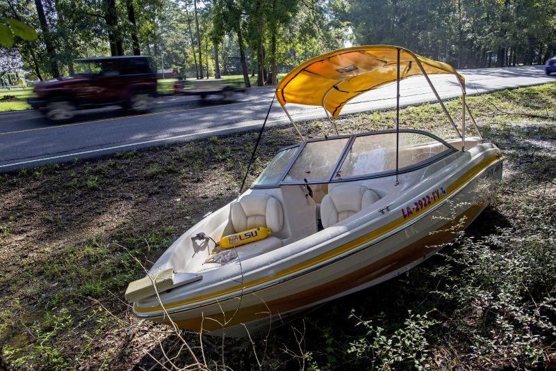 An abandoned boat sits by the side of Walker South Road in Walker, La.