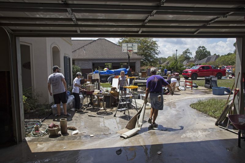 Friends and family help to clean out the flood damaged home of Sheila Siener